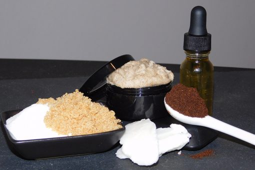 lip scrub jar surrounded by the ingredients